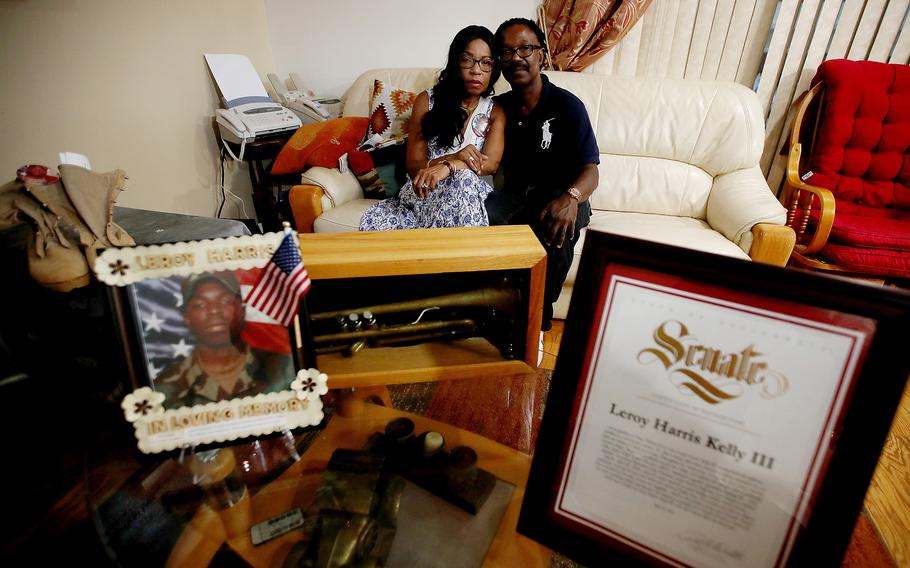 Guiselle and Leroy Harris Jr., the parents of Leroy Harris III, with mementos of their son, including his combat boots, citations, an old trumpet and pictures. A soldier in the U.S. Army, Leroy Harris III was killed in action in 2004 in Iraq.
