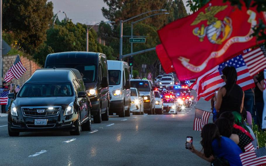The funeral procession for Marine Lance Cpl. Dylan Merola, who was killed in the Kabul airport attack last month, passes his alma mater, Los Osos High School in Rancho Cucamonga on Tuesday, Sept. 21, 2021.