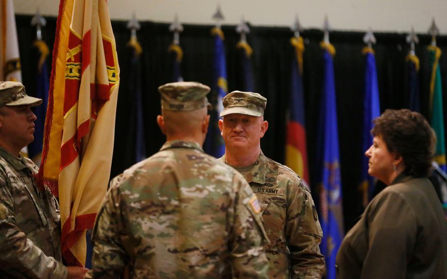 Garrison Commander Colonel Stuart James relinquishes command to incoming Garrison Commander Colonel James Brady in a Fort Bliss Garrison Change of Command Ceremony Thursday, July 8, 2021, at the Fort Bliss Centennial Banquet and Conference Center.