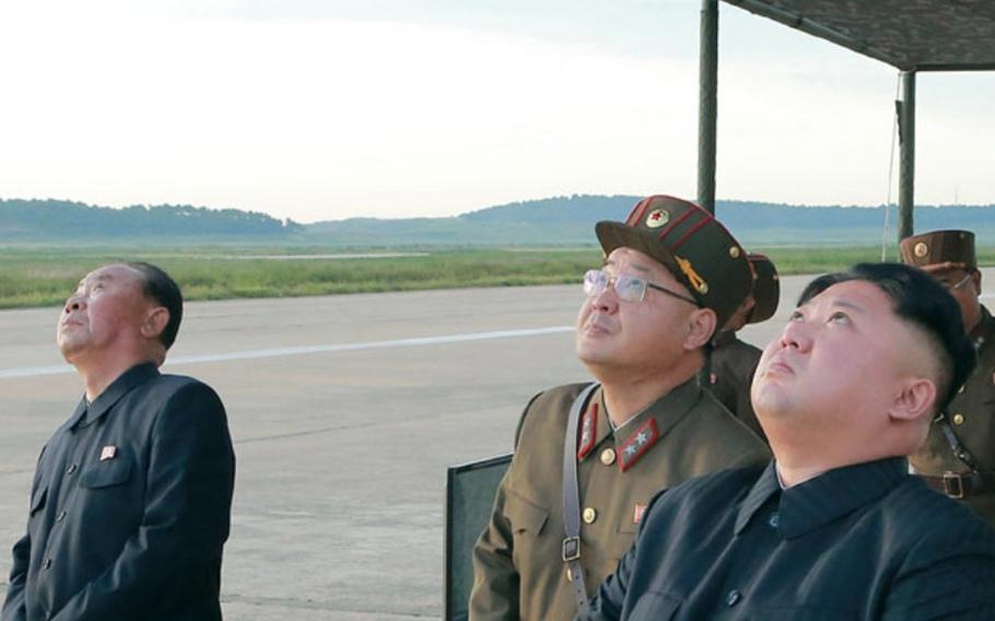 This image from the Korean Central News Agency shows North Korean leader Kim Jong Un and other officials observing a missile test in September 2017.