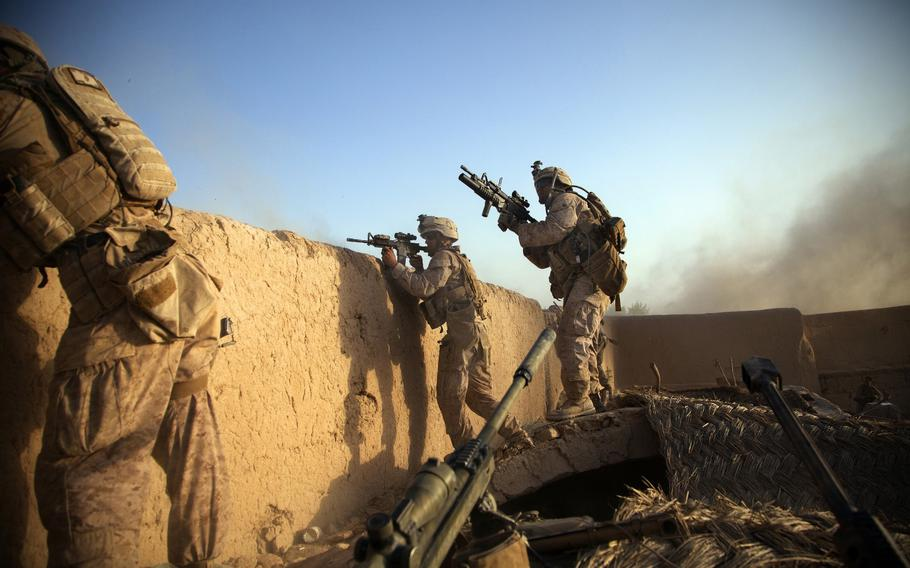 Marines from the 2nd Battalion 5th Marine Regiment return fire in Afghanistan after the enemy fired an RPG rocket at their position on July 15, 2012.