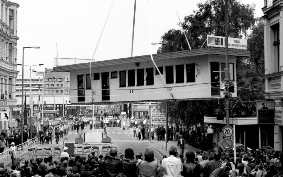 Berlin, June, 1990: Checkpoint Charlie, for decades the key border crossing between the eastern and western portions of divided Berlin, is lifted away to a waiting flatbed truck.