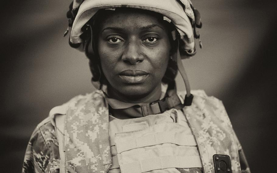 PORTRAIT, 1ST PLACE | U.S. Air Force Staff Sgt. Nadia Rowell stands for a portrait outside the aeromedical evacuation crew tent at Joint Readiness Training Center, Fort Polk, La., on March 15, 2014. Servicemembers at JRTC 14-05 are educated in combat patient care and aeromedical evacuation in a simulated combat environment.