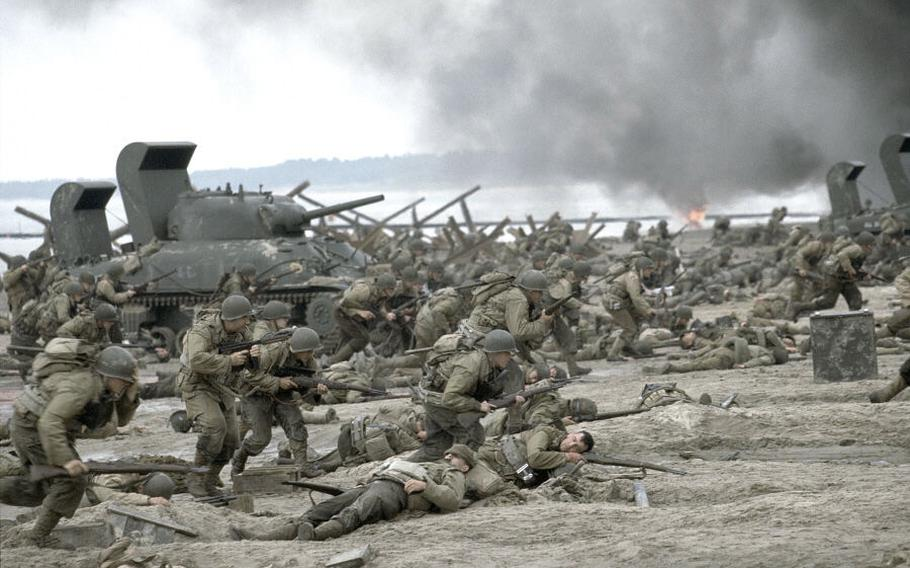 """The American forces storm Omaha Beach during the massive D-Day invasion of Normandy as depicted in the Steven Spielberg movie """"Saving Private Ryan."""""""