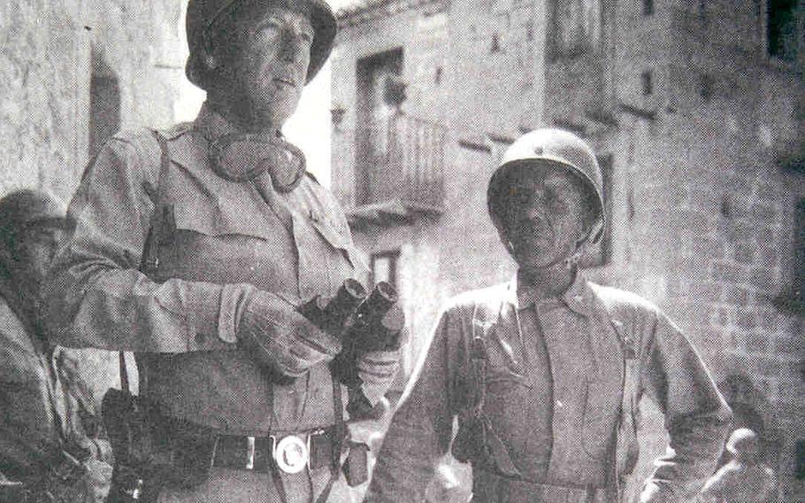 Lt. Gen. George S. Patton, Jr.,left,, and Brig. Gen. Theodore Roosevelt, Jr., confer in a Sicilian town in 1943.