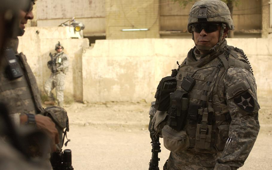 Then-1st. Sgt. Viriato Ferreraramos on patrol with members of Company C, 2nd Battalion, 3rd Infantry Regiment, 2nd Infantry Division, June 2007.