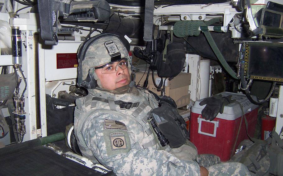 Then-1st Sgt. Viriato Ferreraramos, 1st sergeant for Company C, 2nd Battalion, 3rd Infantry Regiment, 2nd Infantry Division poses for a photograph in his Strkyer while forward deployed to Iraq, Aug. 2006.