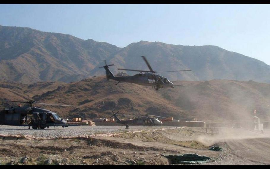 Pararescuemen take off from a forward operating base in an HH-60G Pave Hawk helicopter during Operation Bulldog Bite in November 2010 in Afghanistan.