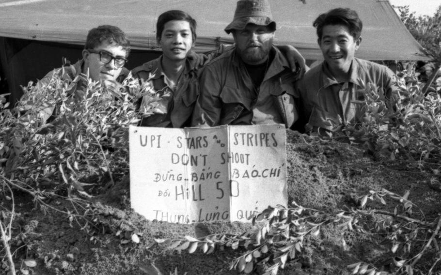 John Olson, left, was a Stars and Stripes photographer in Vietnam.