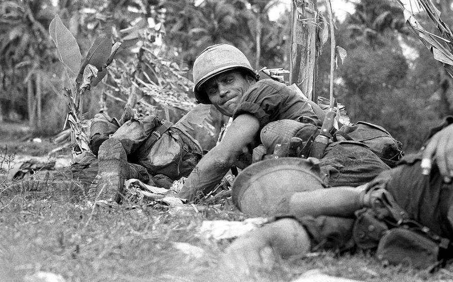 Army Staff. Sgt. Joe Musial, pinned down by enemy fire next to dead and wounded comrades.