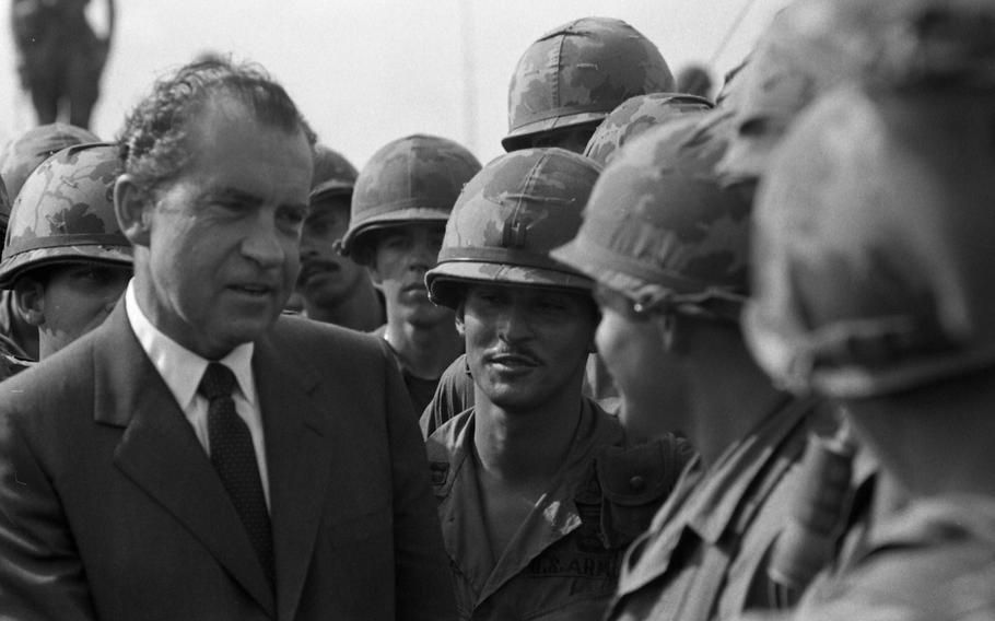 President Richard Nixon chats and shakes hands with the men at the 1st Infantry Division's Di An base camp in South Vietnam on July 30, 1969.