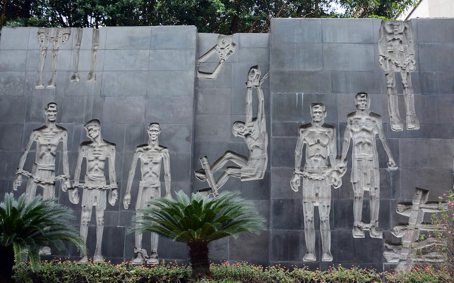 A stone mural memorializes inmates who were tortured and killed at the former Hoa Lo prison, otherwise known as the Hanoi Hilton, which held Vietnamese revolutionaries and later American prisoners of war.