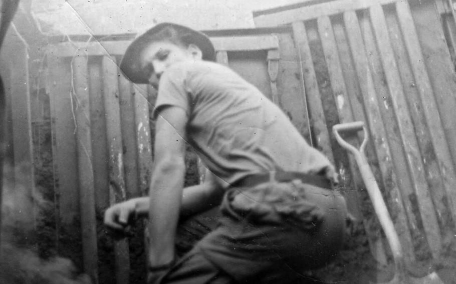 """As described by Rodman Germain: """"Khe Sahn clearing buried conex boxes of bobby traps. That's me, Rod Germain, 326th Combat Engineers, 1970."""""""