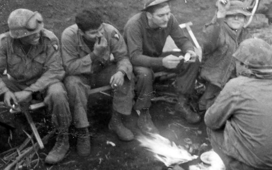 "As described by Rodman Germain: ""Dinner at Khe Sahn as 326th Combat Engineers rebuild the air strip. From left: Biaz, Miguel, Rod, Murphy."""