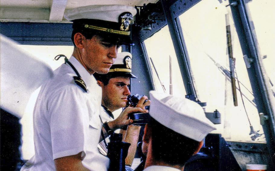 Ensign Bill Gross on the bridge of the USS Diachenko in August 1968 as the ship returns from its deployment to Vietnam and arrives in San Diego, Calif. Behind Gross is Ensign Dennis Devitt.