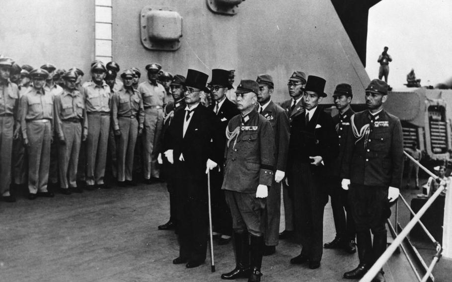 Japanese representatives arrive aboard the USS Missouri in Tokyo Bay to participate in formal surrender ceremonies on Sept. 2, 1945.