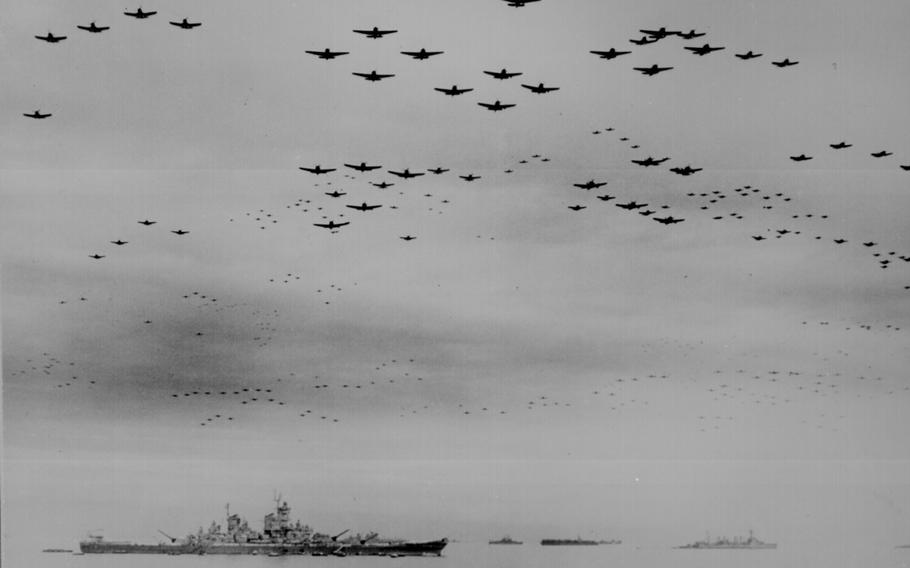American F-4s and British F-6s fly in formation during surrender ceremonies above the USS Missouri in Tokyo Bay, Japan, on Sept. 2, 1945.