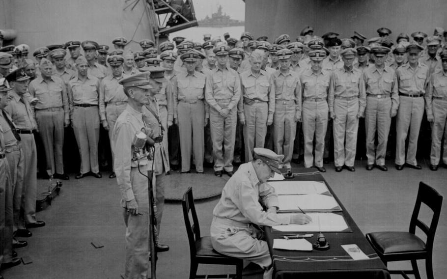 Gen. Douglas MacArthur, Supreme Allied Commander, signs the formal Japanese surrender documents aboard the USS Missouri in Tokyo Bay, Japan, on Sept. 2, 1945.
