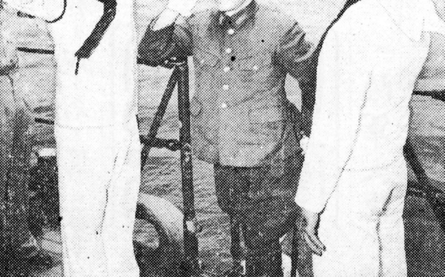 Maj. Imagawa, commander of the Japanese garrison on Rota, believed to number approxmately 4,000 men, comes aboard an American warship, USS Osmus to discuss terms for the surrender of the island which is about 50 miles north of Guam.