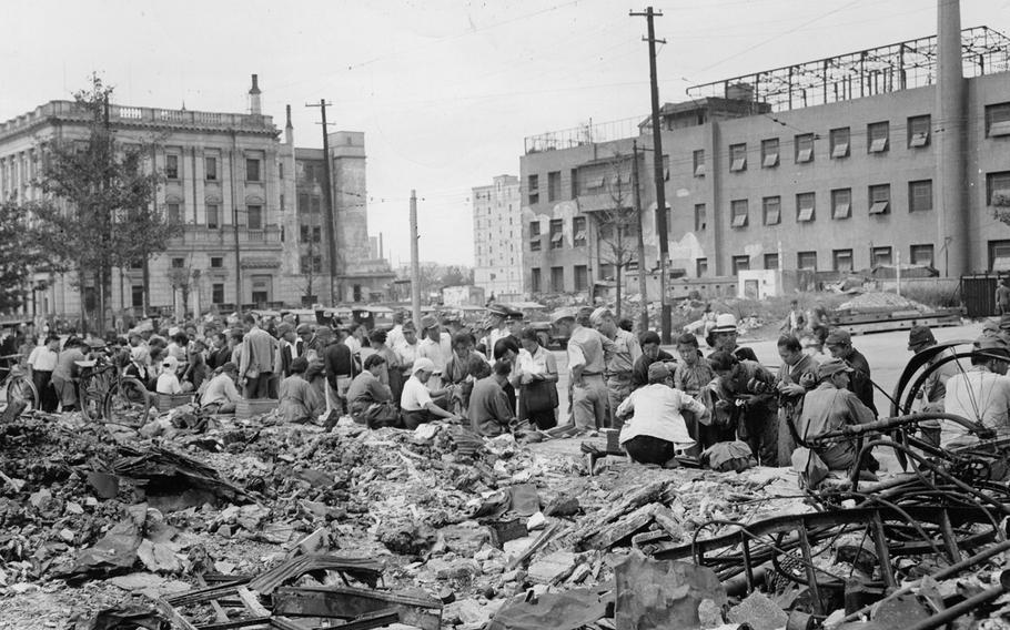 American troops shop at a Tokyo street market on Sept. 17, 1945, amid rubble left by B-29 bombing raids.
