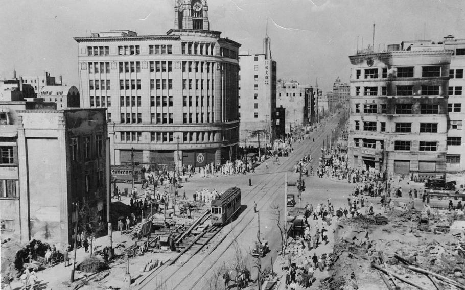 Torn-up streets, burned-out buildings and rubble greeted visitor to Tokyo's Ginza shopping district after the war.