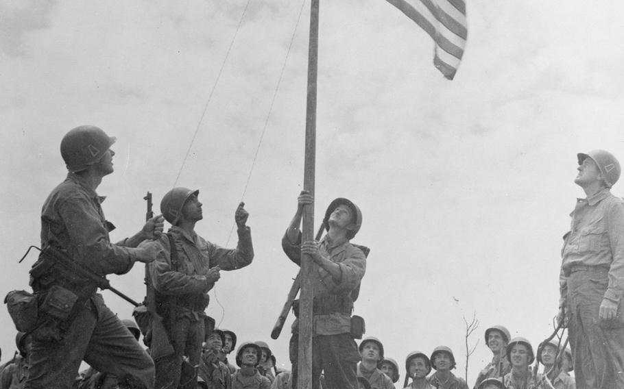 U.S. troops raise the American flag at the end of the 81-day battle for Okinawa.