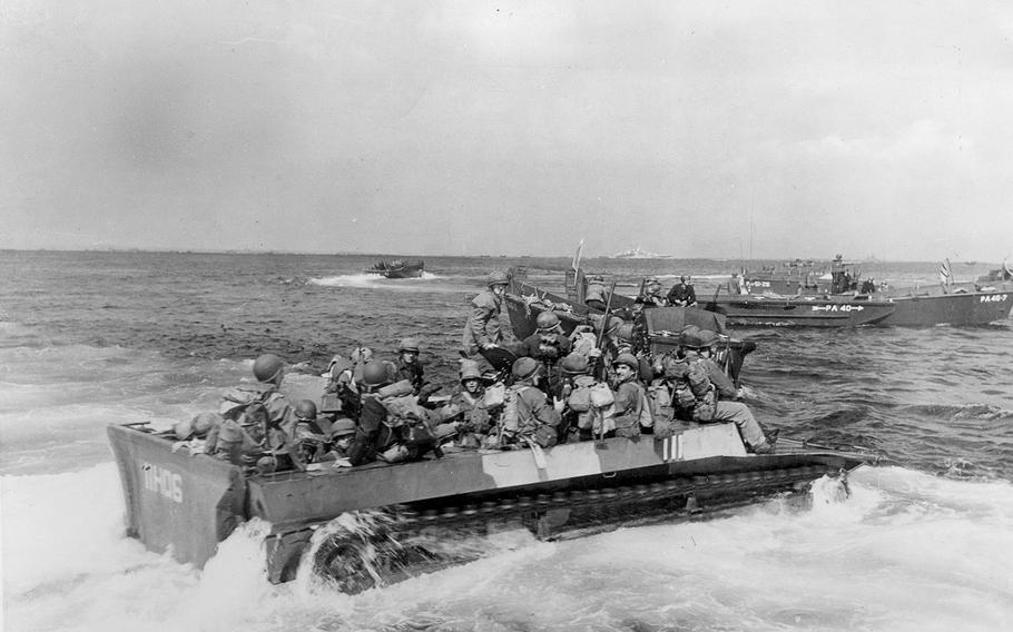 Troops of the U.S. 7th Infantry Division head for the beach in light tracked vehicles at the beginning of the Battle of Okinawa, on April, 1945.