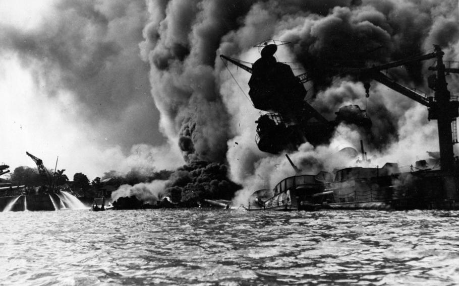 The USS Arizona burns as it sinks into the waters at Pearl Harbor, Hawaii, on Dec. 7, 1941. The attack pulled America into World War II.