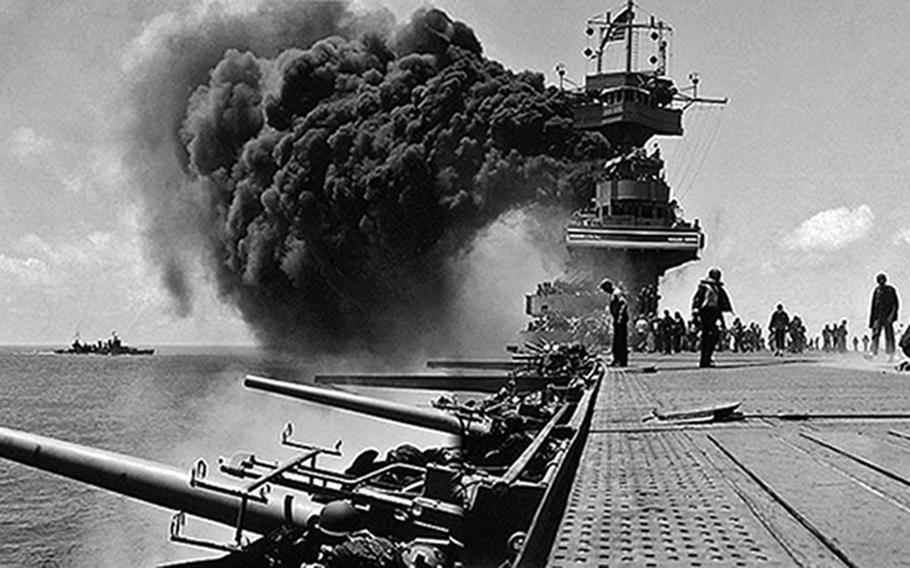 The USS Yorktown burns during the Battle of Midway. Although the U.S. lost the Yorktown and a destroyer, the Japanese lost four heavy carrier, evening out the naval power of both sides.