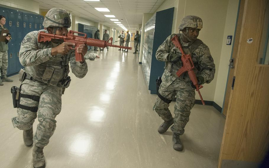 Staff Sgt. Pierre Johnson and Staff Sgt. Carl Higgins, patrolmen with the 51st Security Forces Squadron, clear the second floor of Osan Middle School during an active shooter exercise at Osan Air Base, South Korea, Nov. 13, 2014.