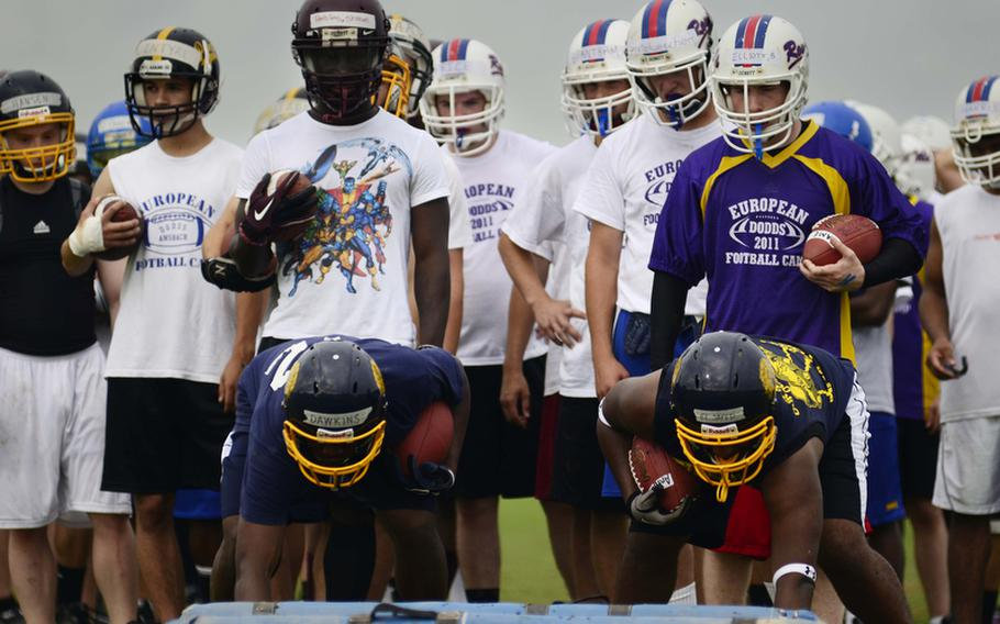 """Running backs line up to do """"bag drills"""" to improve footwork at this year's DODDS-Europe football camp in Ansbach, Germany. More than 350 football players from eight American high schools and five local national teams are participating in the annual preseason camp that ends Wednesday."""