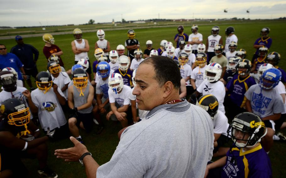 in Hairstone, a Bitburg Middle School teacher, gives instructions at the DODDS-Europe football camp in Ansbach, Germany. More than 350 football players from eight American high schools and five local national teams are participating in the annual preseason camp that ends Wednesday.