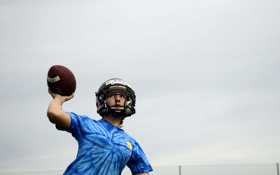 Anna Gruber, 16, a sophomore from Hohenfels High School, goes through  quarterback drills at this year's DODDS-Europe football camp in Ansbach, Germany. More than 350 football players from eight American high schools and five local national teams are participating in the annual preseason football camp that ends Wednesday.