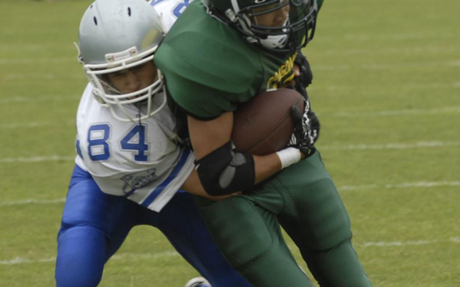 Brussels' Will Cole brings down Alconbury's Matt Geronimo after a short gain Saturday in a 44-6 victory by the Dragons.