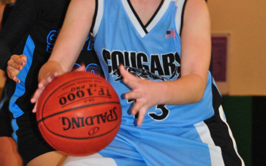 Senior forward Ashley LaFortune is the lone returner on an Osan American Cougars girls basketball team that's young and inexperienced.