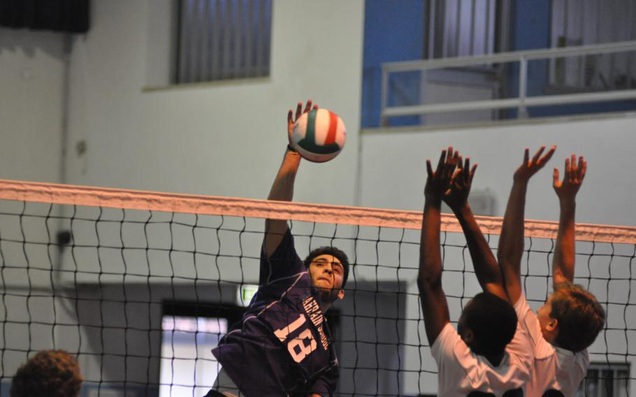 Bahrain's Abraham Kayal spikes the ball past the Marymount defense Saturday during pool play in the 2012 Mediterranean Volleyball Championships at Aviano Air Base, Italy. Bahrain won the match 25-21, 27-25, but Marymount qualified to play in the final.