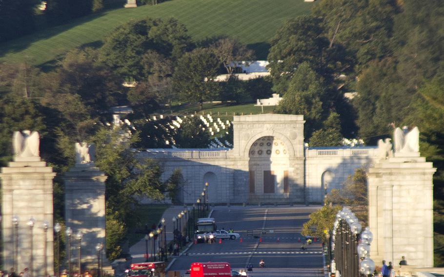 With the early-morning sun illuminating the Custis-Lee Mansion and Arlington National Cemetery in the background, competitors in the wheelchair and hand-crank categories of the Army 10-Miler cross the bridge into Washington, D.C. on Oct. 20, 2013.