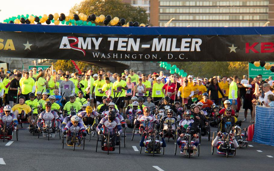 Wounded Warriors get on their way at the 29th annual Army 10-Miler, October 20, 2013.