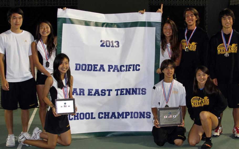 American School In Japan players strike a pose with the overall school Division I banner Thursday following the Far East High School Tennis Tournament at Kadena Air Base, Okinawa. The Mustangs also won the boys D-I title and three event gold medals, boys singles and doubles and mixed doubles. From left, top row Kentaro Ishihara, Lili Kobayashi, Teri Cho, Luke Yamasaki and Yosuke Higashi; bottom row Nana Yoshimura, Len Kamemoto and Saki Fujita.