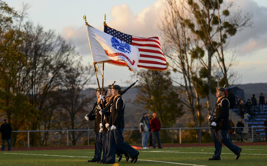 The Wiesbaden High School JROTC color guard performs Saturday night before the start of the DODDS-Europe high school football all-star game in Wiesbaden, Germany.