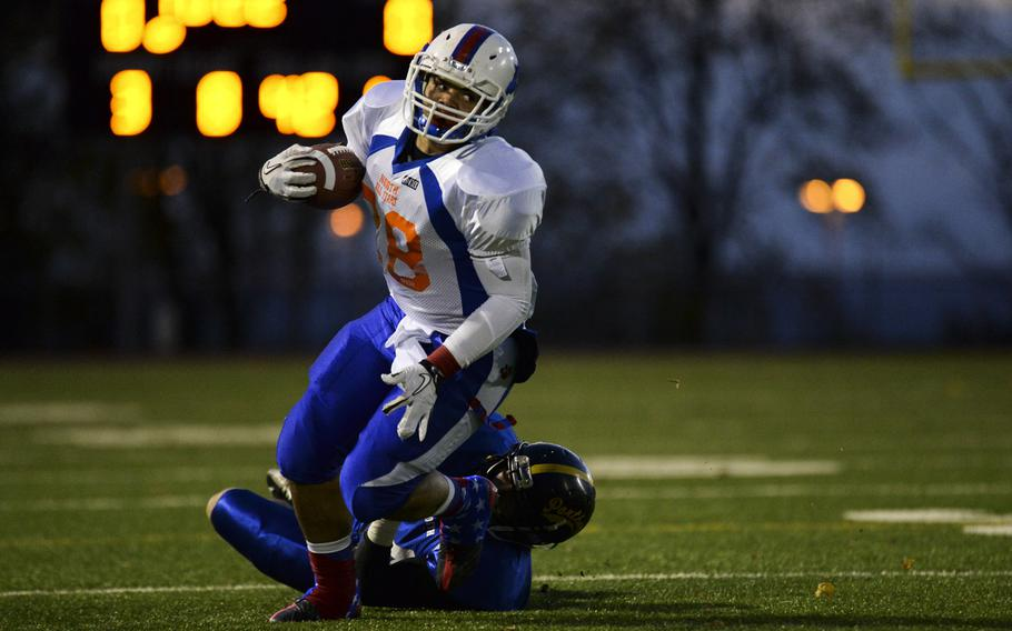 North squad's Tevin Johnson gets past a South squad defender Saturday night in the DODDS-Europe high school football all-star game in Wiesbaden, Germany.