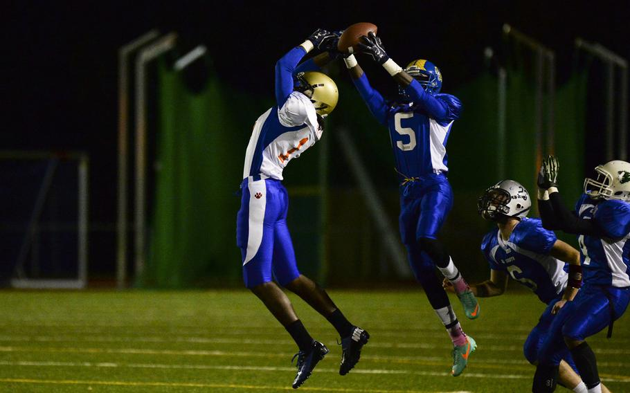 South squad's Brian Debel intercepts a pass intended for North squad's CJ Pridgen ON Saturday night in the DODDS-Europe high school football all-star game in Wiesbaden, Germany.