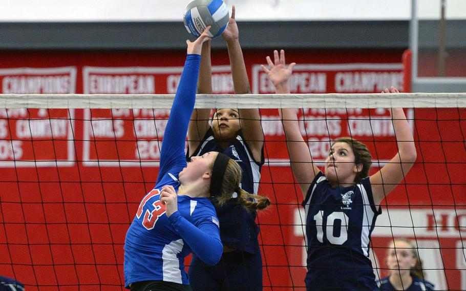 Ramstein's Sarah Schiller, left, battles Lakenheath's Jourdan Hodge and Bailee Hughes in an opening day Division I match at the DODDS-Europe volleyball championships. The two teams later met in the finals. Schiller and Hodge were selected to the 2013 DODDS All-Europe volleyball team