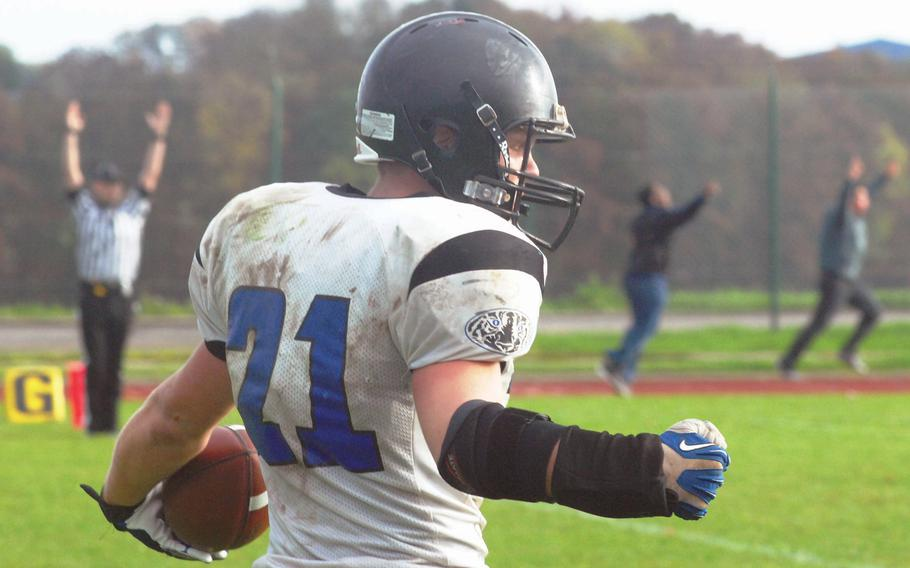 Hohenfels running back David Vidovic celebrates his fourth-quarter go-ahead touchdown run in Hohenfels' 38-28 Division II semifinal win against Bitburg, Oct. 26, 2013. Bitburg's loss snapped a 36-game winning streak for the four-time defending champions. Hohenfels went on to take the Division II crown with a win over SHAPE a week later.