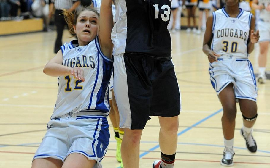 Bitburg's Brianna Lackey goes in for a basket late in the second half against Ansbach's Karen Kukla in the Division II title game at the DODDS-Europe Basketball Championships in Wiesbaden, Germany, Feb. 23, 2013.Sixth-seeded Bitburg beat Ansbach 49-39 to complete its run from underdog to champion at the tournament.