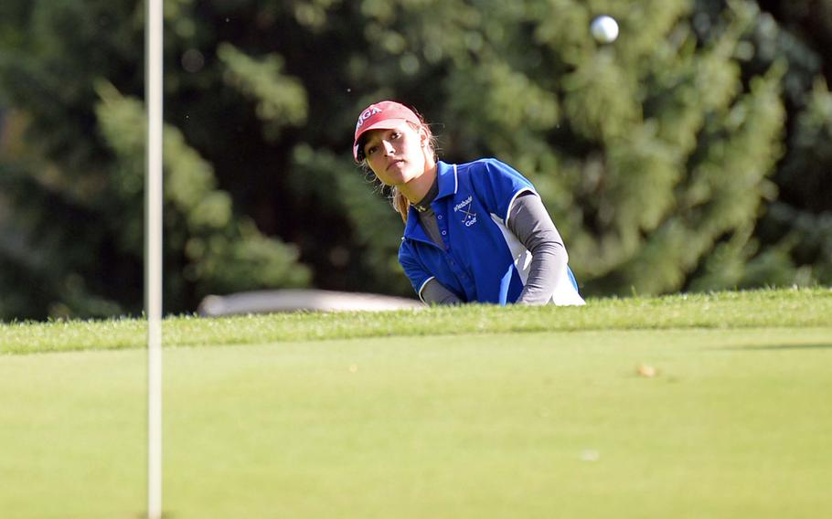 Wiesbaden's Jenna Eidem chips to the green on her way to winning her third straight DODDS-Europe girls golf title at Wiesbaden, Germany, Oct. 10, 2013.