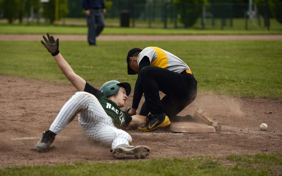 Naples' Joseph Pitts steals third base in the Division II & III championship game at the 2013 DODDS-Europe baseball championships at Ramstein Air Base, Germany, May 25, 2013. The game was the first time two Italy-based teams had played for a European baseball crown.