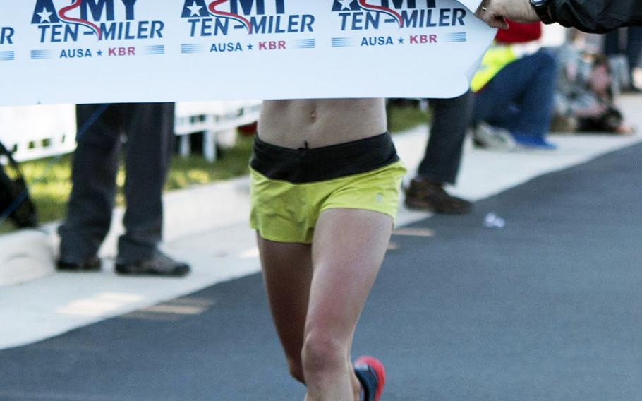 Kerri Gallagher is the first woman to cross the finish line at the 2014 Army Ten-Miler, October 12, 2014.