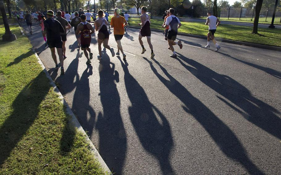 The early-morning sun casts long shadows during the 30th Army Ten-Miler in Arlington, Va. and Washington, D.C., Oct. 12, 2014.