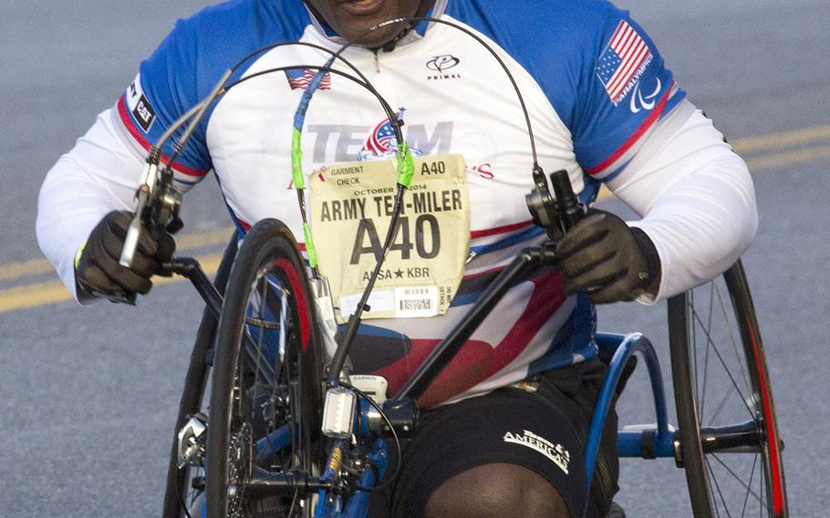 Retired Army Col. Gregory Gadson, who most recently served as garrison commander at Fort Belvoir, Va., competes in the Army Ten-Miler, Oct. 12, 2014.